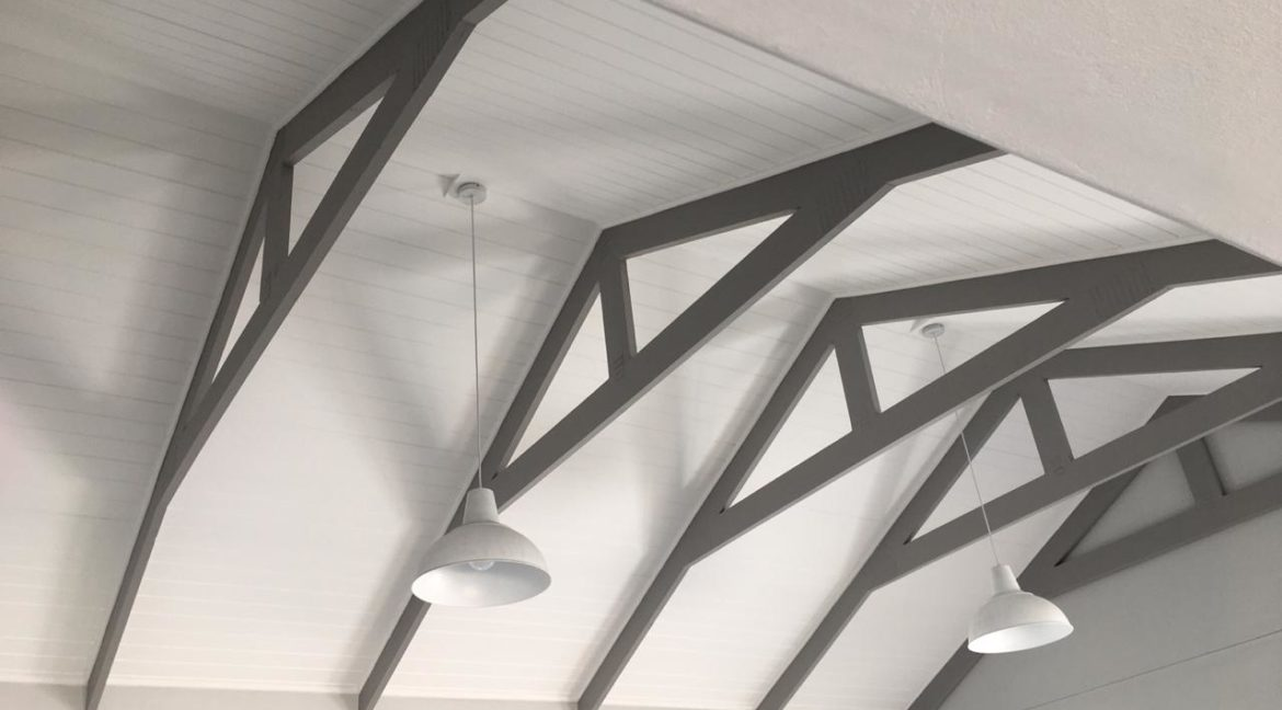 Double volume ceiling with exposed trusses