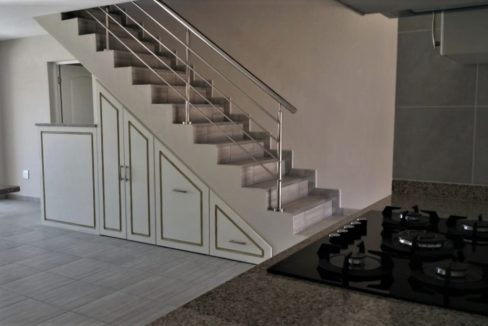 Stairs and cupboards as well as small bar area